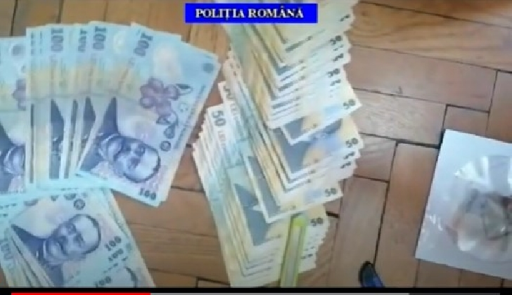 3 persoane care se ocupau cu falsificarea de bancnote au fost retinute de politistii prahoveni (video)